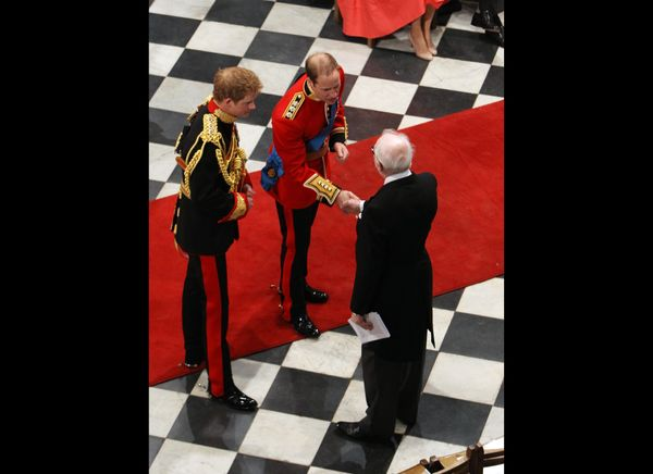 Prince Harry and Prince William greet a guest while waiting for the arrival of Kate.   (Getty photo)