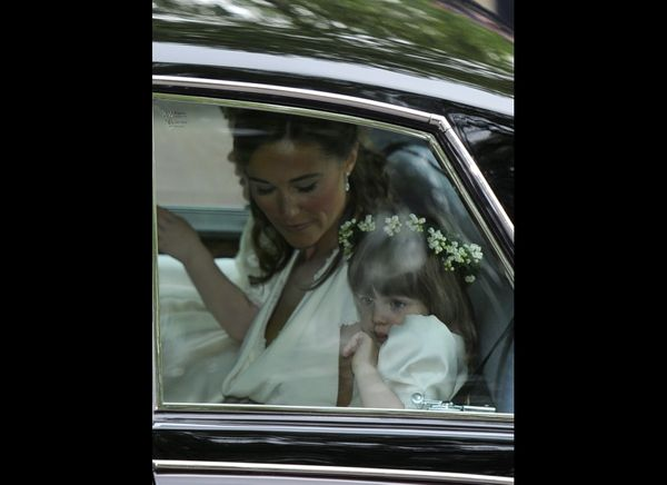 Pippa Middleton and Eliza Lopez on their way to the ceremony.  (AFP photo)