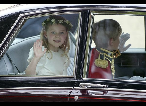 Flower girl Margarita Armstrong-Jones waives on her way to the ceremony.   (Getty photo)