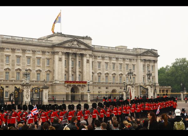 Ceremonial guards perform near Buckingham Palace.  (Getty photo)