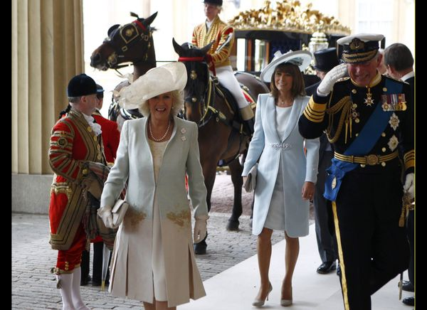 Prince Charles, Camilla, Duchess of Cornwall and Carole Middleton arrive at Buckingham Palace after the wedding ceremony. (AF