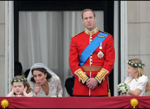 Kate bends down to talk to a flower girl onthe balcony of Buckingham Palace. (WireImage photo)