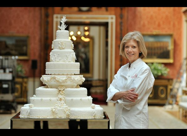 Cake designer Fiona Cairns standing in front of the royal wedding cake she designed. (AFP photo)