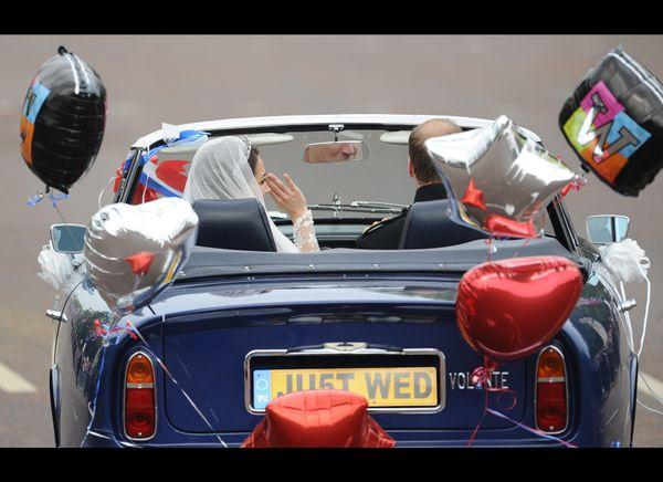 The couple leaving Buckingham Palace.  (AFP photo)