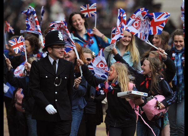 Children waving British flags during the royal wedding. (AFP photo)