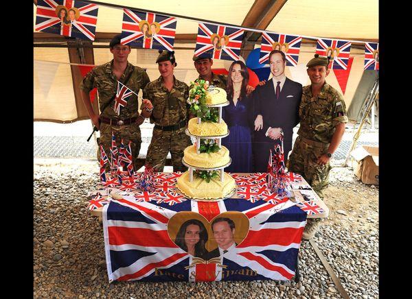 Soliders in Lashkar Gah, Afghanistan celebrating the royal wedding. (Getty photo)