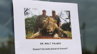 <p>A sign posted on the door of Walter Palmer's dental practice on July 28, 2015.</p>