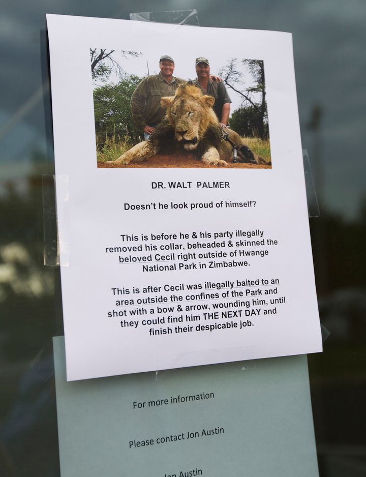 A sign posted on the door of Walter Palmer's dental practice on July 28, 2015.