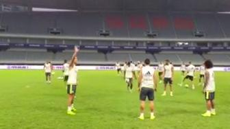 Cristiano Ronaldo waves to fans in China.