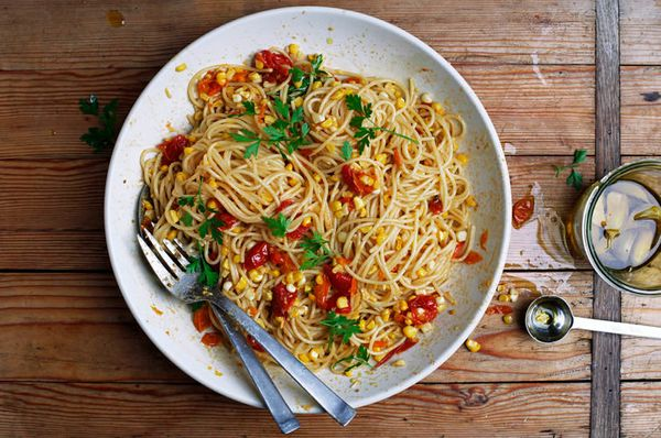 "<strong>Get the <a href=""http://food52.com/recipes/29365-pasta-with-corn-slow-cooked-tomatoes-and-garlic-confit"" target=""_bla"