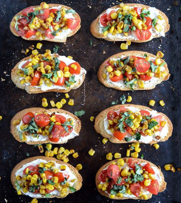 "<strong>Get the <a href=""http://www.howsweeteats.com/2013/06/summer-crostini-with-whipped-roasted-garlic-goat-cheese/"" target"