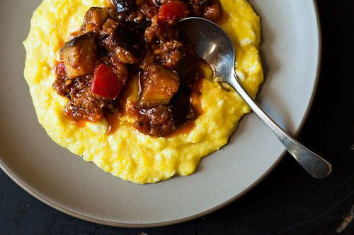 "<strong>Get the <a href=""http://food52.com/recipes/18519-yotam-ottolenghi-s-sweet-corn-polenta-with-eggplant-sauce"" target=""_"