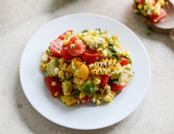 "<strong>Get the <a href=""http://www.howsweeteats.com/2013/07/embarrassingly-easy-grilled-corn-tomato-salad-with-blue-cheese-a"