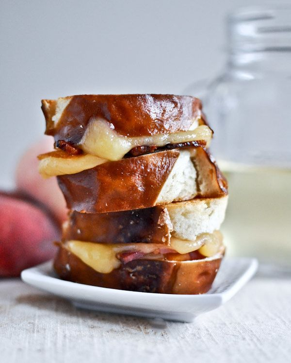 "<strong>Get the <a href=""http://www.howsweeteats.com/2012/07/peach-bacon-gouda-grilled-cheese-sliders-on-pretzel-bread/"" targ"