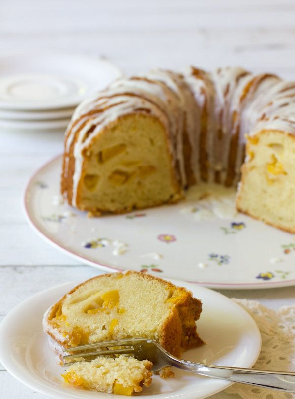 "<strong>Get the <a href=""http://www.aspicyperspective.com/2013/05/peach-cake.html"" target=""_blank"">Peaches N' Cream Cake reci"