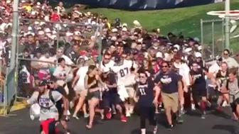 New England Patriots fans stampede through the gates of training camp.