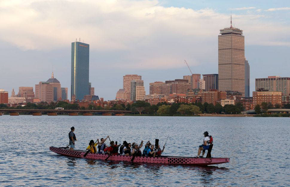 A boat glides down the Charles River, which may have hosted Olympic events, as Boston's bid to host the 2024 games died