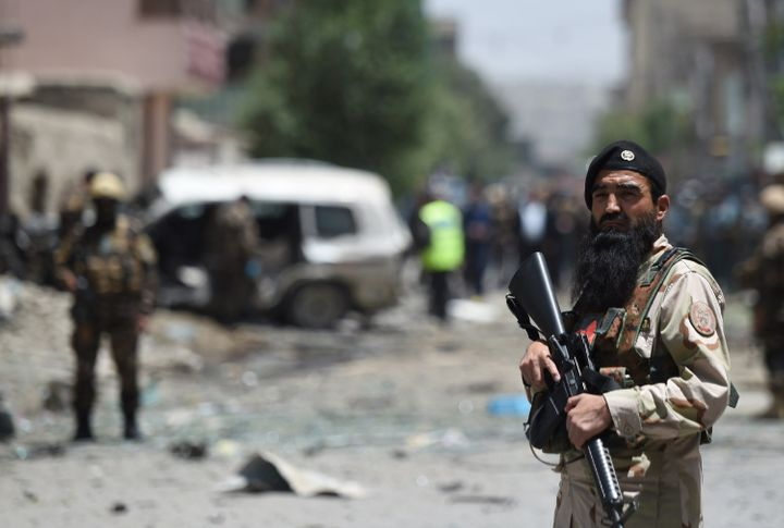 <span>Afghan security forces guard the site of a bomb blast that the Taliban carried outto target NATO forces in Kabul,