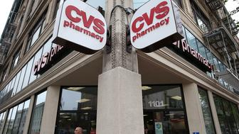 SAN FRANCISCO, CA - JUNE 15:  A pedestrian walks by a CVS store on June 15, 2015 in San Francisco, California.  CVS Health announced that it has agreed to acquire Target's pharmacy and clinic businesses for an estimated $1.9 billion.  (Photo by Justin Sullivan/Getty Images)