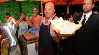 <p>Food writer Andrew Zimmern, left, with someone who probably hasn't tried donkey before.</p>