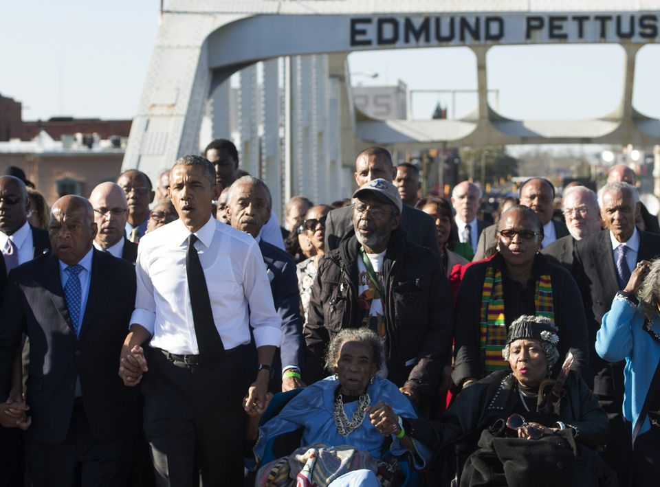 President Barack Obama (second from left) and U.S. Rep. John Lewis (left), a Democrat of Georgia and one of the original marc
