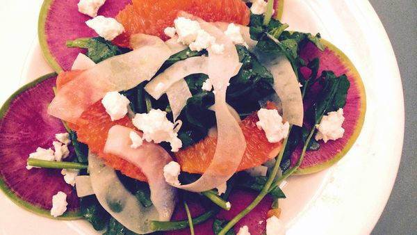 Radish salad sounds so humdrum, but this plate is anything but. It uses watermelon radishes, a variety that is pale on the ou