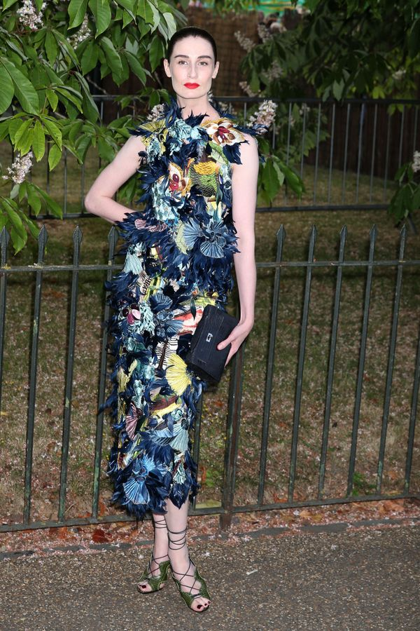 <span>The modellooks like summer (literally) at the Serpentine Gallery summer party in London.</span>