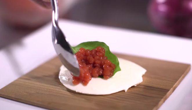 <p>Tomato pearls on fresh mozzarella.&nbsp;</p>