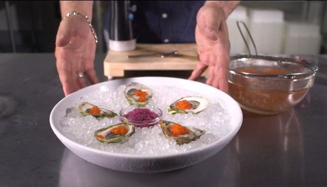 Red onion and wine vinegar pearls at center; Tabasco sauce pearls on oysters.