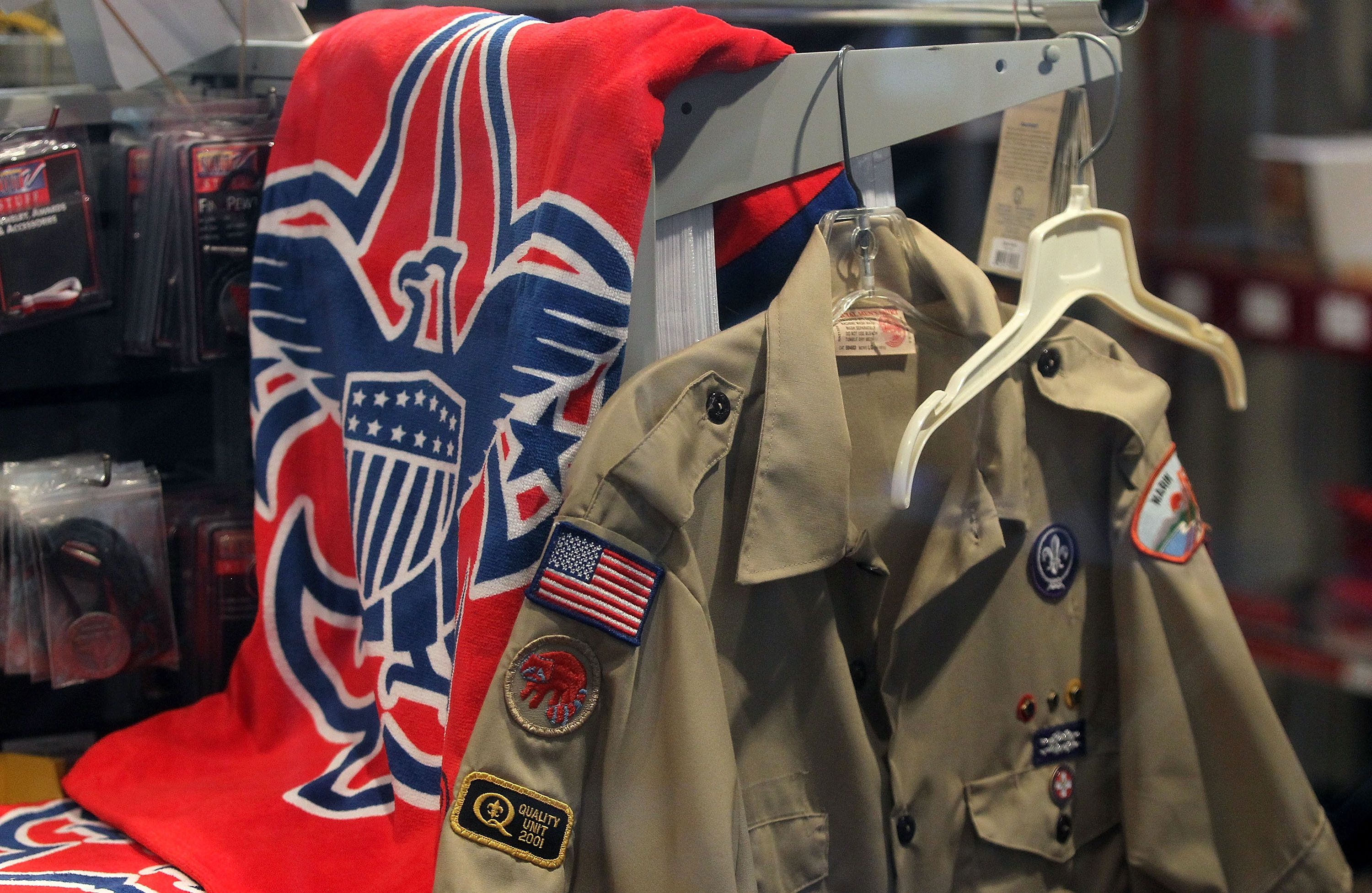 SAN RAFAEL, CA - JULY 27:  The Boy Scout logo and a uniform are displayed in a store at the Marin Council of the Boy Scouts of America on July 27, 2015 in San Rafael, California. The national executive board of the Boy Scouts of America is poised to vote to end a ban on gay adult leaders.  (Photo by Justin Sullivan/Getty Images)