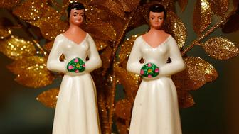 WEST HOLLYWOOD, CA - JUNE 10:  Same-sex wedding cake topper figurines are seen at Cake and Art June 10, 2008 in West Hollywood, California. Business is increasing sharply for local wedding services in the days leading up to the start of legal marriages for gay and lesbian couples on June 17. Same-sex weddings could grow the California wedding industry by $684 million and, over the next three years, add $64 million to the state's budget, a study by the Williams Institute at UCLA's law school reports. The California Supreme Court refused to stay its decision legalizing same-sex marriage despite calls by conservative and religious opponents for the court to stop same-sex couples from marrying before an initiative to amend the state constitution to ban gay marriage goes to ballot in November.  (Photo by David McNew/Getty Images)