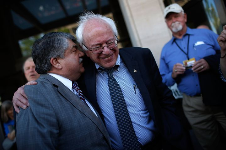 AFL-CIO president Richard Trumka (L) and Sanders (R) share a moment at an April rally. Sanders' skepticism of guest worker pr