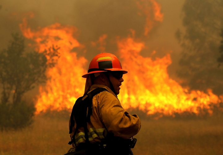 <span><span>A firefighter monitors flames from the Rocky Fire as it approaches a home on July 31, 2015 in Lower Lake, Califor