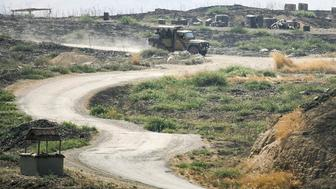 GAZIANTEP, TURKEY - JULY 28: Turkish Army's tanks and artilleries stand guard as they are alerted, in southeastern Turkey's border city Gaziantep's Karkamis District on July 28, 2015. Turkey increase security level on the borders after a gunfire to Turkish border post from Syria across the border killed a Turkish non-commissioned officer and wounded two sergeants in Turkeys southern Kilis province. Turkish forces has been started artillery attacks and heavy air-strikes over Daesh terrorists as well as terrorist group PKK. Also, PKK had been started deadly terrorist activities inside the Turkey. (Photo by Ensar Özdemir/Anadolu Agency/Getty Images)