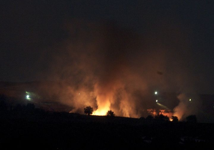 <span>Flames are seen from Turkey's Gaziantep province after ISIS&nbsp;opened fire on the PYD-controlled village of Zormagara