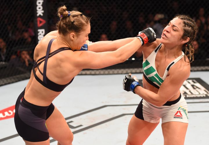 Ronda Rousey of the United States punches Bethe Correia of Brazil in their UFC women's bantamweight championship bout during