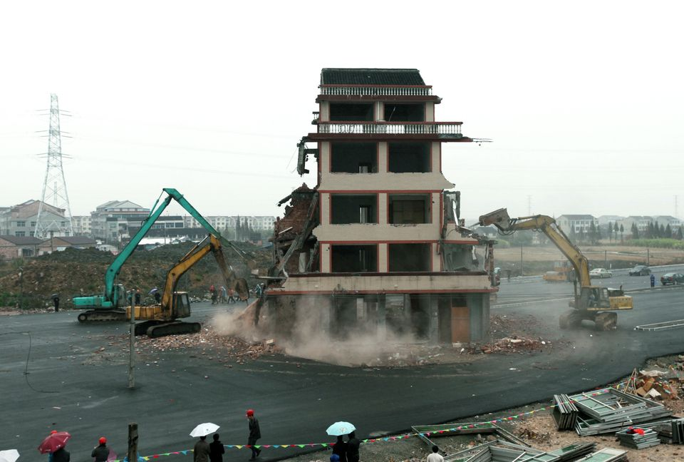 "A ""nail house"" in the middle of a road in central China is finally demolished in 2012."
