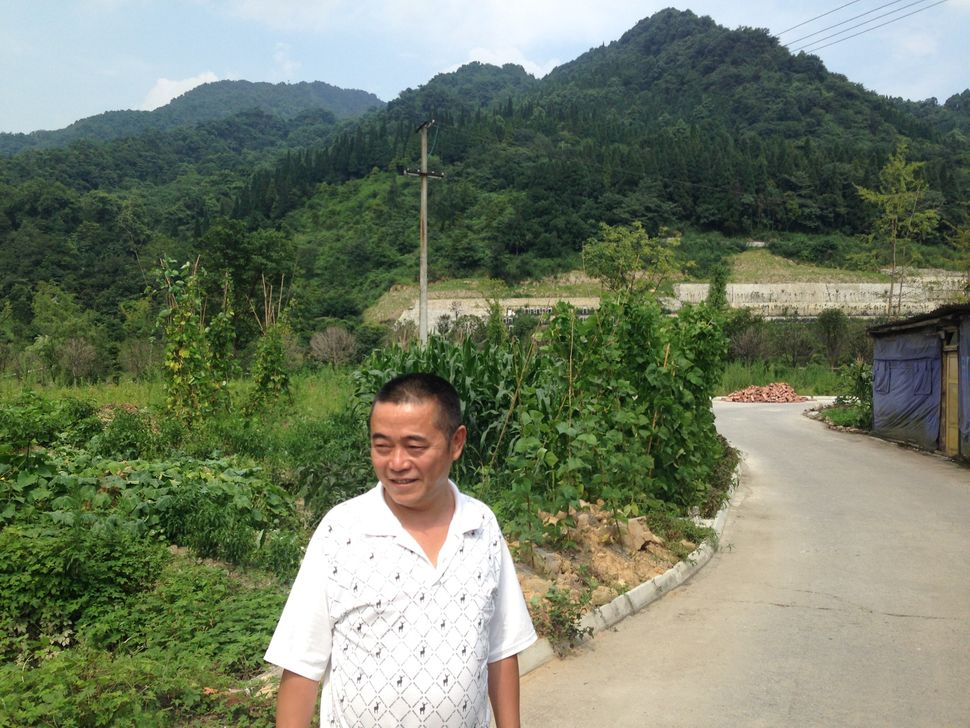 Huang Qi visiting the area affected by the 2008 Wenchuan earthquake.