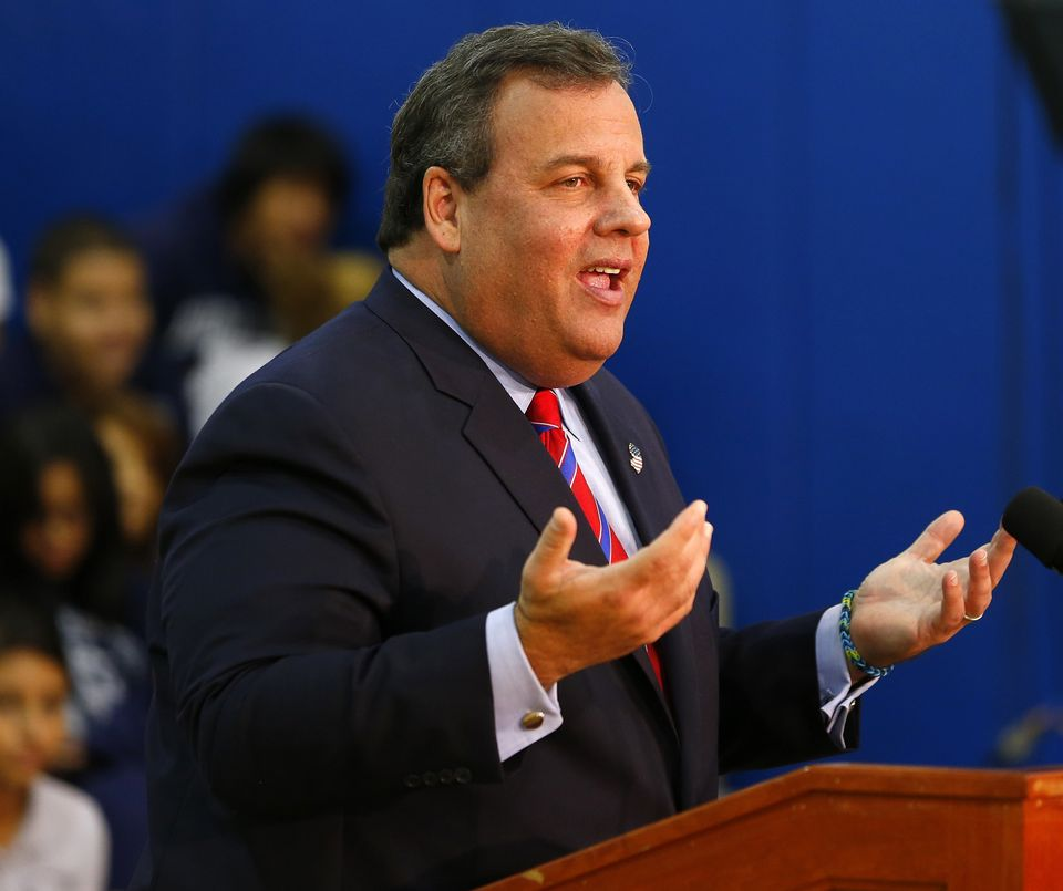 New Jersey Gov. Chris Christie talks to the media as he visits Jose Marti Freshman Academy in Union City, N.J. Wednesday, Nov