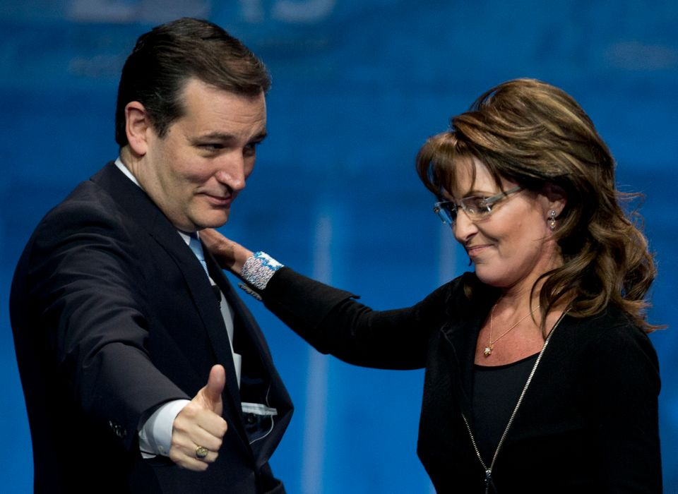Sen. Ted Cruz (R-Texas) left, greets Former Alaska Gov. Sarah Palin (R) after introducing her at the 40th annual Conservative