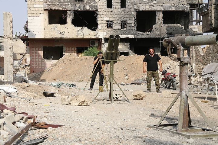 Members of Free Syrian Army of Syrian opposition make preparations before they stage an operation on Assad's regime fo