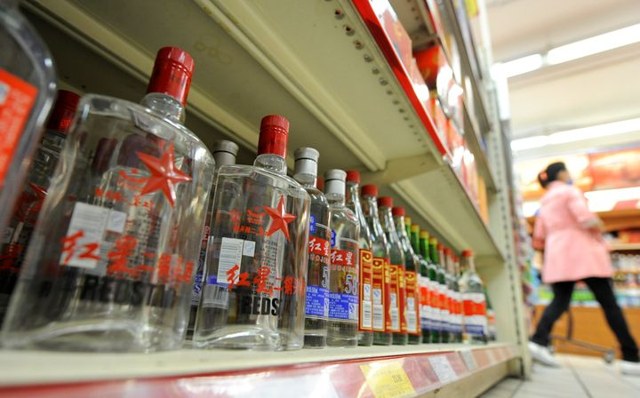 <span>Bottles of baijiu are displayed at a store in Beijing on October 18, 2011. Ask any Westerner what they think is the wor