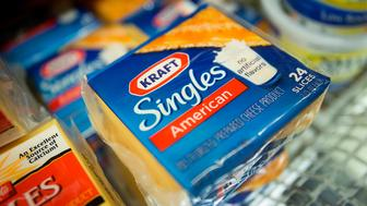 Packages of Kraft Foods Group Inc. Singles cheese slices are displayed for sale at a supermarket in New York, U.S., on Monday, Nov. 5, 2012. Kraft Foods Group Inc. is scheduled to release earnings data on Nov. 7. Photographer: Scott Eells/Bloomberg via Getty Images