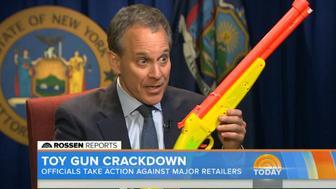 New York Attorney General Eric T. Schneiderman brandishes a legal toy gun.