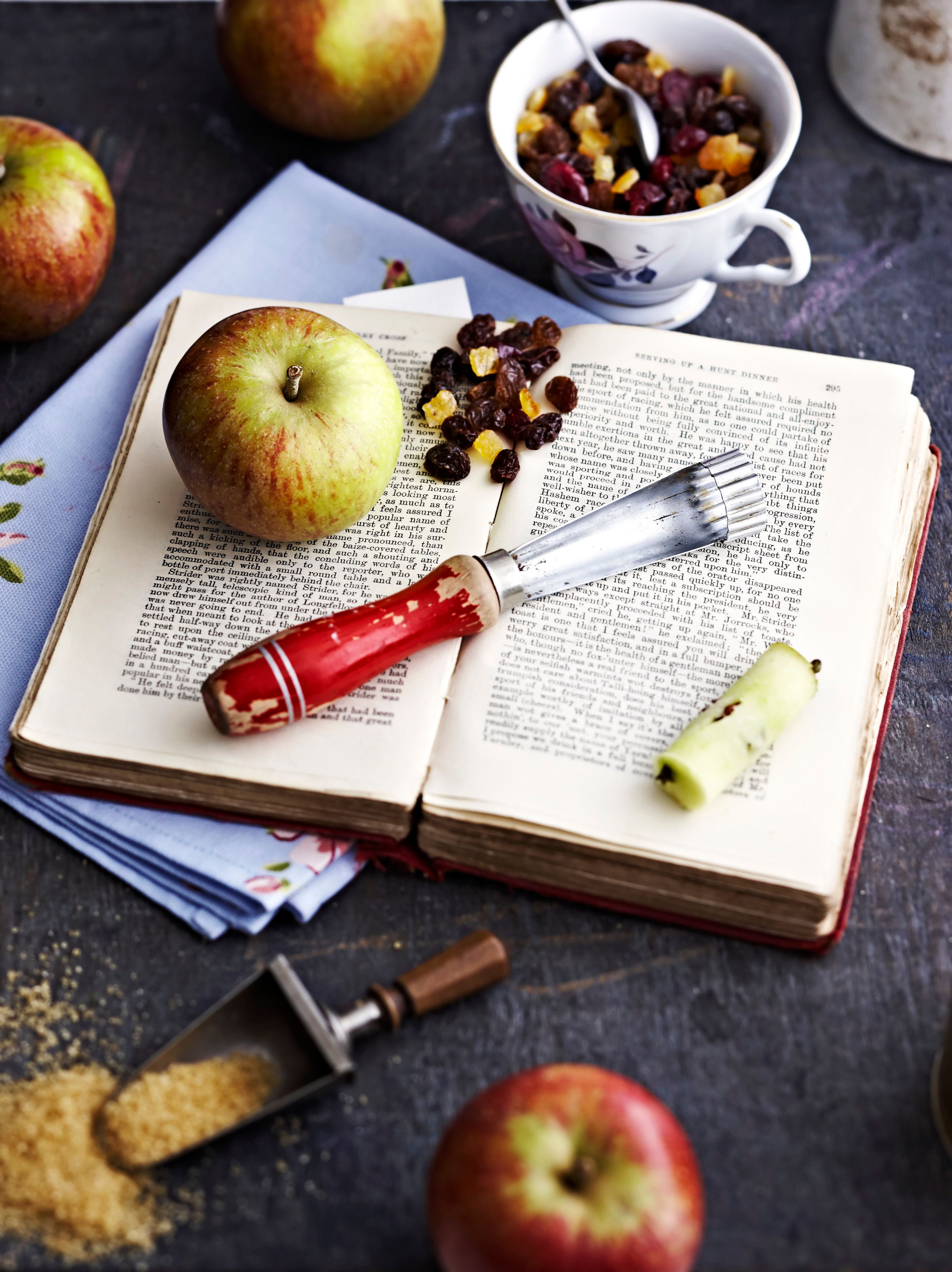 Cook book with ingredients for baked apples