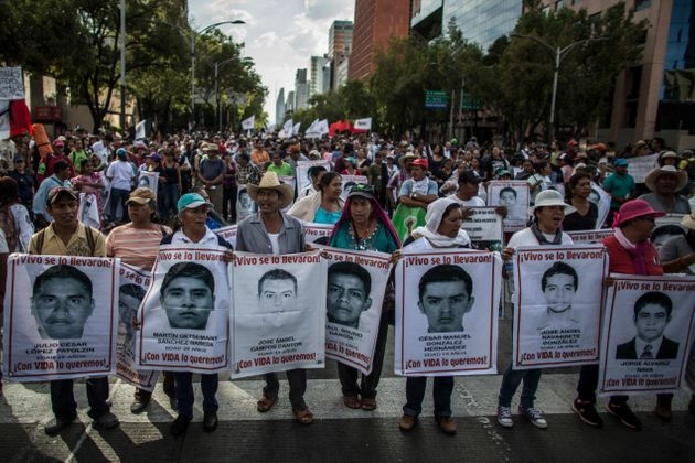 Demonstrators and relatives of the 43 missing students of Ayotzinapa college march during a protest rally ten months after the students disappearance on July 26, 2015 in Mexico City.