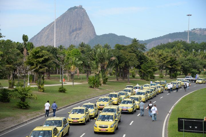 <span>Hundreds of taxi drivers from Rio de Janeiro, Sao Paulo and Belo Horizonte block the avenue which links South and Cente