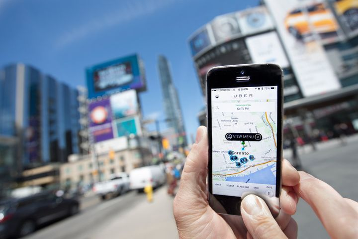 <span>TORONTO, ON - MAY 14 - Photographed at Dundas Square, Toronto, Uber taxi service is a new alternative way to traditiona