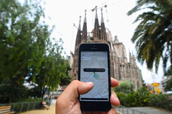 <span> BARCELONA, SPAIN - JULY 01: In this photo illustration the new smart phone taxi app 'Uber' shows how to select a