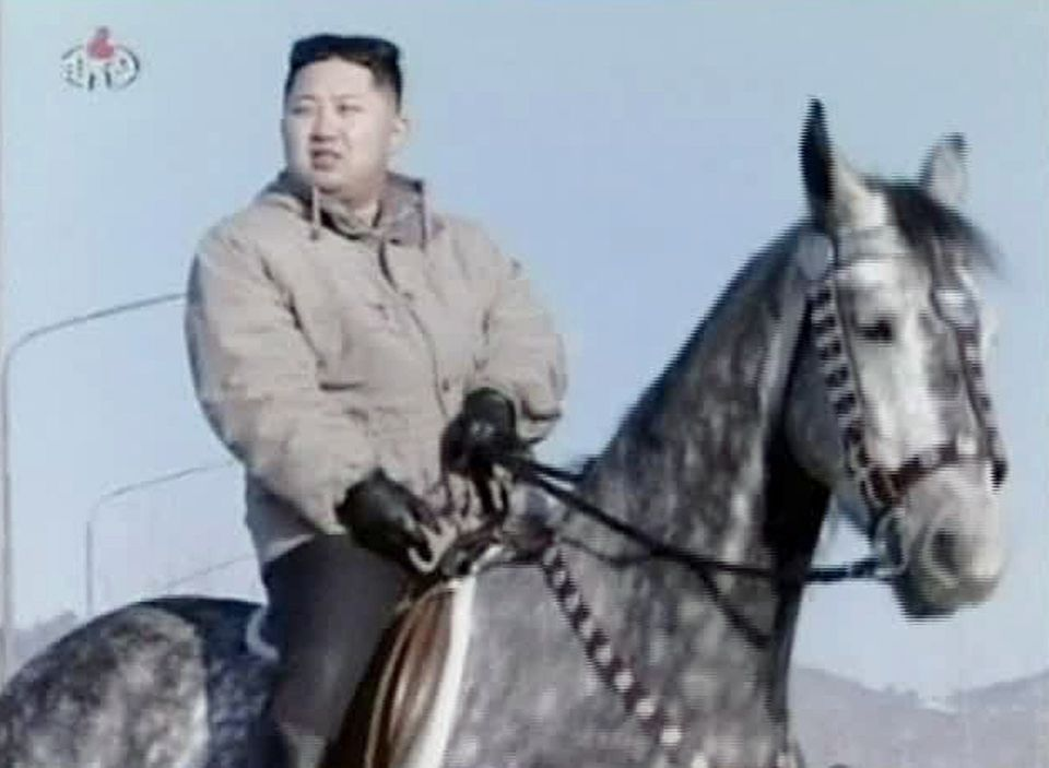 In this undated image made from KRT video, North Korea's new young leader Kim Jong Un rides a horse at an undisclosed place i